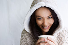 Attractive young lady enjoying a cup of coffee Stock Images