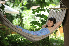 Attractive young lady in a hammock Royalty Free Stock Photography