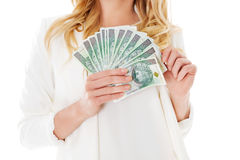 Attractive young lady holding cash and happy smiling over white background. Stock Photo