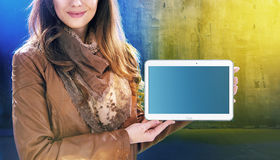 Attractive young lady holding a tablet. Attractive young woman holding a tablet Stock Photo