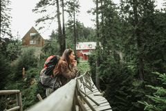Attractive young lady leaning against wooden bridge stock photo
