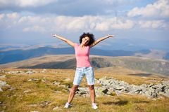 Attractive young lady outdoor in mountains Royalty Free Stock Photos