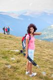 Attractive young lady outdoor in mountains Stock Photo