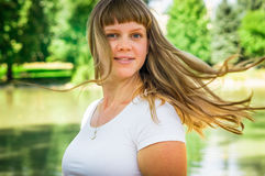 Attractive young lady in park enjoying in the nature Stock Photo