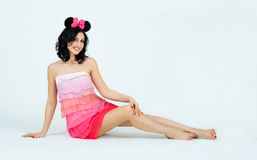 Attractive young lady in pink dress posing Royalty Free Stock Photos