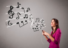 Attractive young lady singing and listening to music with musica Stock Image
