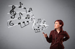 Attractive young lady singing and listening to music with musica Stock Images