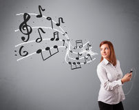 Attractive young lady singing and listening to music with musica Royalty Free Stock Images