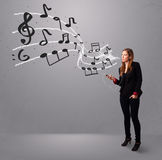 Attractive young lady singing and listening to music with musica. L notes getting out of her mouth Stock Photography