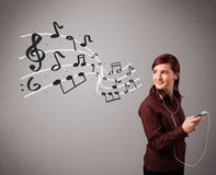 Attractive young lady singing and listening to music with musica Royalty Free Stock Image