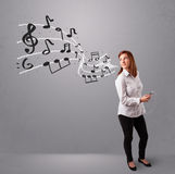 Attractive young lady singing and listening to music with musica Stock Photo