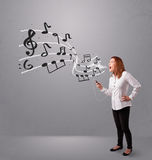 Attractive young lady singing and listening to music with musica Royalty Free Stock Photo