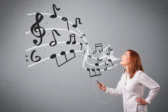 Attractive young lady singing and listening to music with musica Royalty Free Stock Photography