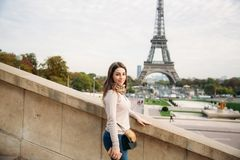Attractive young lady stand in centre of paris. Background of eiffel tower. Travel royalty free stock photography