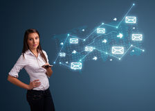 Young lady holding a phone with arrows and message icons Stock Photo