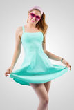 Attractive young lady in turquoise dress Royalty Free Stock Image