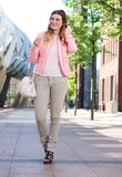 Attractive young lady walking in the city Stock Photo