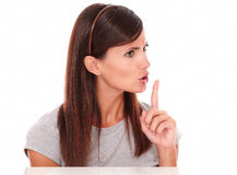 Attractive young latin woman commanding silence Stock Photo