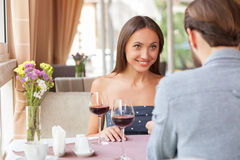 Attractive young loving couple is dating in cafe Royalty Free Stock Photo