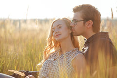 Attractive young loving couple is dating in the Stock Images