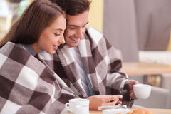 Attractive young loving couple is resting in cafe Stock Photos