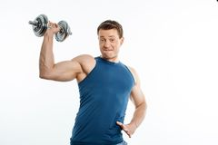 Attractive young male athlete is exercising with Royalty Free Stock Photo