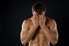Attractive young male athlete is expressing shame Royalty Free Stock Photography