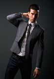 Attractive young male fashion model in suit jacket and tie Royalty Free Stock Image
