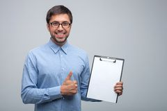 Attractive young male manager with positive royalty free stock image