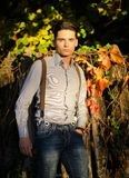 Attractive young male model in fall (autumn). Attractive young male model outdoors in nature in beautiful sunset light Royalty Free Stock Image