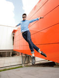 Attractive young male model jumping outdoors Royalty Free Stock Photo
