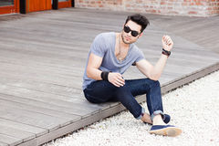 Attractive young male model posing outdoors stock photography