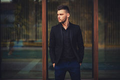 Attractive young male model in suit royalty free stock photography