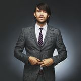 Attractive young male model wearing stylish suit. Portrait of attractive young male model wearing stylish suit. Businessman getting read for work. Asian Stock Image