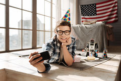 Attractive young male person having birthday party Stock Images