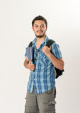 Attractive young male student. Over a white background Stock Photography