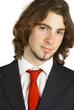 Attractive young man. An Attractive young man with a formal suit and red tie Stock Photography