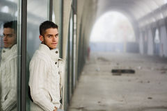 Attractive young man in abandoned empty tunnel Royalty Free Stock Image