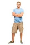 Attractive young man with arms folded on white background Royalty Free Stock Images