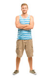 Attractive young man with arms folded on white background Stock Images