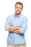 Attractive young man with arms folded on white background Stock Photo