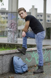 Attractive young man with backpack standing royalty free stock images