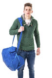 Attractive young man with bag on shoulder strap Royalty Free Stock Photos