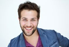Attractive young man with beard smiling on white background Royalty Free Stock Photos