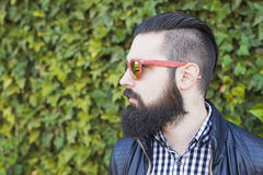 Attractive young man with beard speaks on the phone. royalty free stock photo