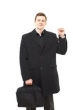 Attractive young man in black coat on white Stock Images