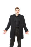 Attractive young man in black coat on white Stock Photography