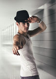 Attractive young man with black fedora in a Stock Photo