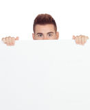 Attractive young man with a blank placard. Isolated on white background Royalty Free Stock Photo