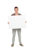 Attractive young man with a blank placard. Isolated on white background Royalty Free Stock Image